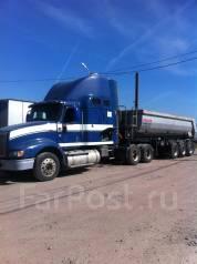 International 9400i. , 12 700 куб. см., 24 500 кг.