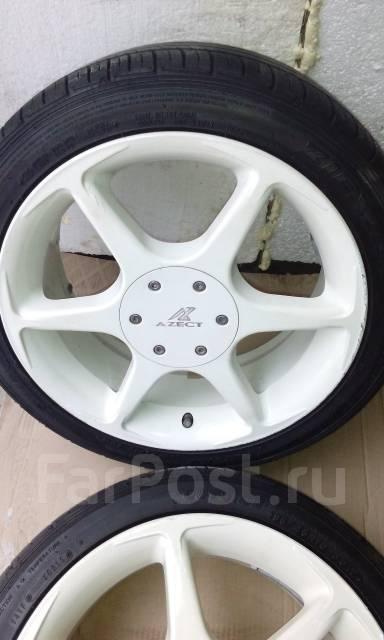 Комплект летних колес 195/45 R16 Azect. 6.5x16 4x100.00, 4x114.30 ET32 ЦО 65,0мм.
