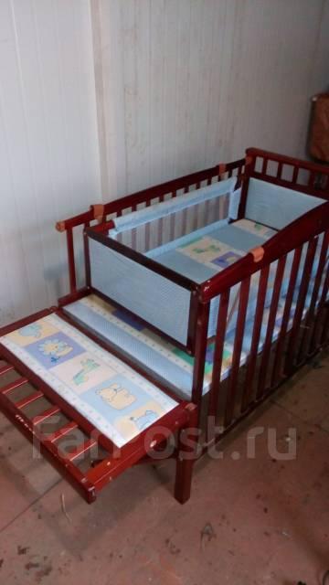 Продам детскую кроватку с калыбелью трансформер производство япония