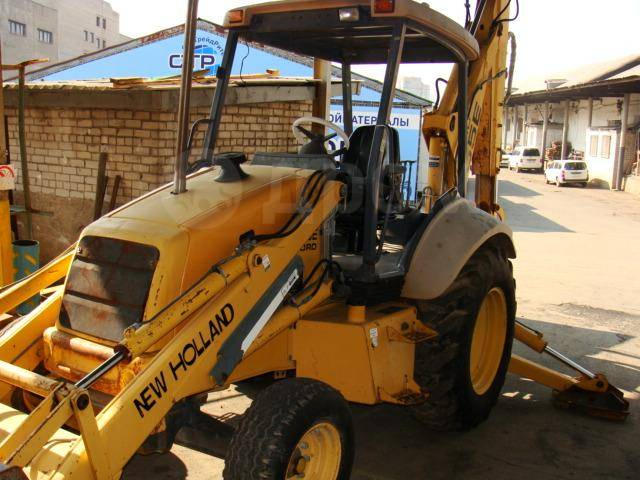 New Holland. Ford Blackhoe 555E RWD, 0,50 куб. м.