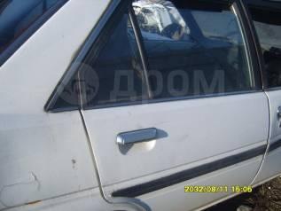 Дверь. Toyota Carina