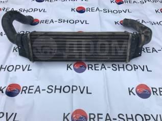 Радиатор интеркулера. SsangYong Rexton