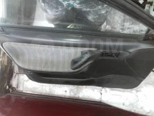 Обшивка двери. Mazda Familia