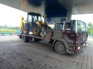 Услуги по перевозке тракторов, погрузчиков, катков, спецтехники и всего