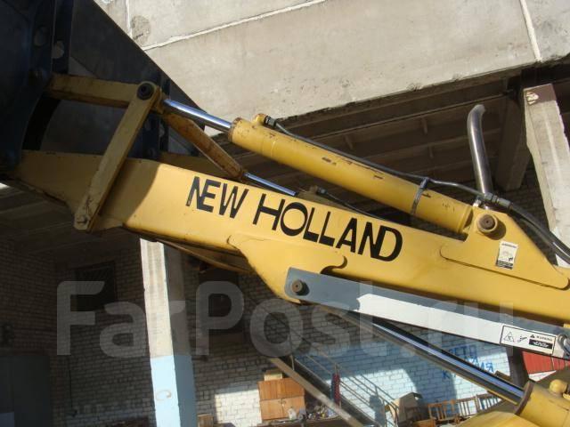New Holland. Ford Blackhoe 555E RWD, 5 500 куб. см., 0,50куб. м.
