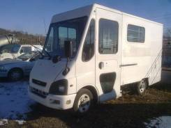 Isuzu. Begin, 3 200 куб. см., 1 000 кг.
