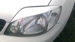 Накладка на фару. Toyota Corolla, NZE120