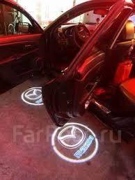Эмблема. Mazda