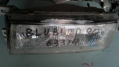 Фара 10063319 на Nissan Bluebird U12 Левая