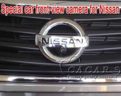 Камера переднего вида в логотип Nissan.
