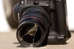 Сломанный фотоаппарат, видеокамера, объектив