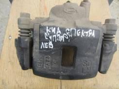 Суппорт тормозной. Kia Spectra