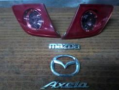 Эмблема. Mazda Axela
