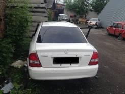 Накладка на дверь багажника. Mazda Familia, BG5P