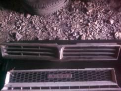Решетка радиатора. Toyota Camry, 303135