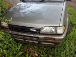 Капот. Mazda Familia