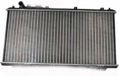 Радиатор охлаждения двигателя. Mazda 323