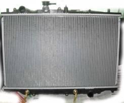 Радиатор охлаждения двигателя. Mazda 929