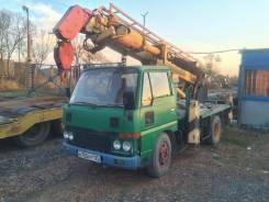 Nissan Condor. Автобуровая (ямобур) , 3 290 куб. см., 3 000 кг.