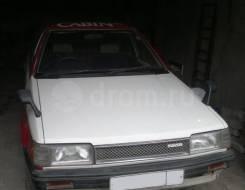 Передний бампер Mazda Familia год 84-90