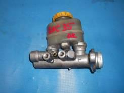 Цилиндр главный тормозной. Nissan Laurel, GNC35