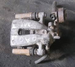 Суппорт тормозной. Opel Astra