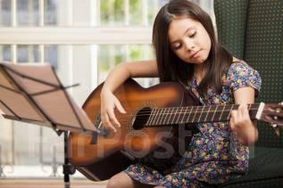 Обучение игре на гитаре.