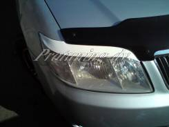 Накладка на фару. Toyota Corolla Fielder