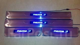 Накладка на порог. Mazda Mazda3, BM Двигатели: P5VPS, PEVPS, SHVPTS, ZMDE