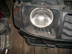 Фара. Mitsubishi Pajero, V26C, V26WG, V26W