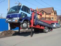 Nissan Diesel. Японский грузовик эвакуатор, 7 000куб. см., 5 001кг.