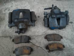 Суппорт тормозной. Toyota: Vitz, bB, Raum, Funcargo, Sienta, ist, Platz, Probox Двигатели: 1SZFE, 2SZFE, 2NZFE