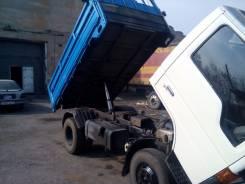 Mazda Titan. Подается грузовик, 4 021 куб. см., 2 170 кг.