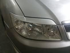 Накладка на фару. Toyota Corolla Fielder, NZE121