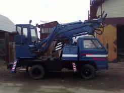 Isuzu Elf. Продам грузовик с эксковаторной установкой Isuzu ELF
