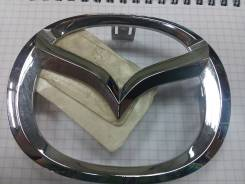 Эмблема передняя решетки радиатора оригинал Mazda D350-51-731