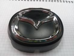 Эмблема решетки радиатора оригинал Mazda DC03-51-734A