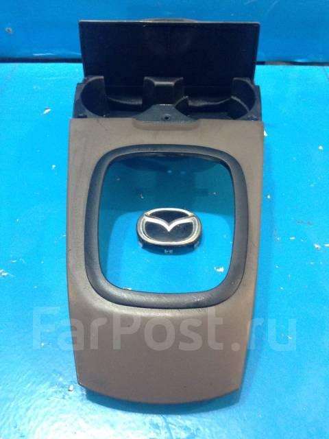 Консоль центральная. Mazda Protege Mazda Familia, BJ3P, BJ5P, BJ5W, BJ8W, BJEP, BJFP, BJFW Mazda 323 Двигатели: B3, B3ME, ZL, ZLDE, ZLVE