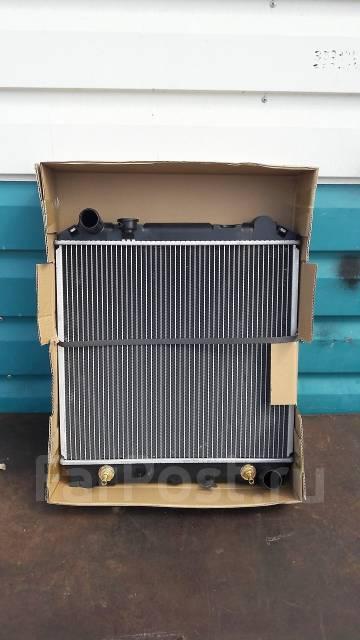 Радиатор охлаждения двигателя. Isuzu Elf, NKR66 Двигатель 4HF1