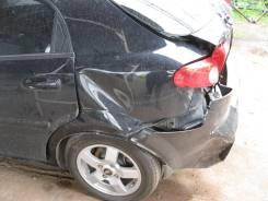 Щит опорный задний левый Chevrolet Lacetti