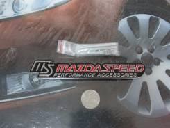 Эмблема решетки. Mazda