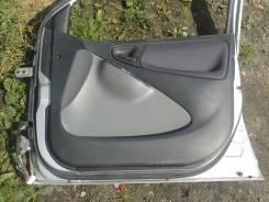 Обшивка двери. Toyota Vitz, SCP10, NCP10