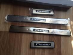Накладка на порог. Mazda Demio