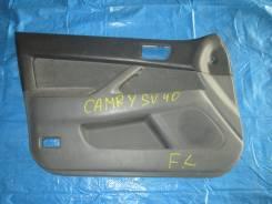 Обшивка двери передней левой Toyota Camry