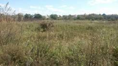 Продам участок в Уссурийске. 1 128 кв.м., собственность, электричество, от агентства недвижимости (посредник). Фото участка