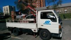 Mazda Titan. с манипулятором, 4 021 куб. см., 2 250 кг.