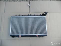 Радиатор охлаждения двигателя. Nissan Primera, P10