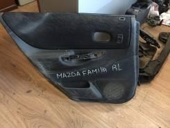 Обшивка двери Mazda Familia S-Wagon, левая задняя