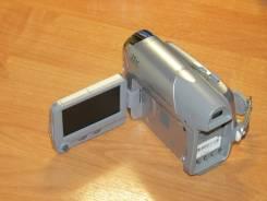Canon MD120. Менее 4-х Мп, с объективом