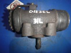 Тормозной цилиндр NISSAN DIESEL, левый, задний